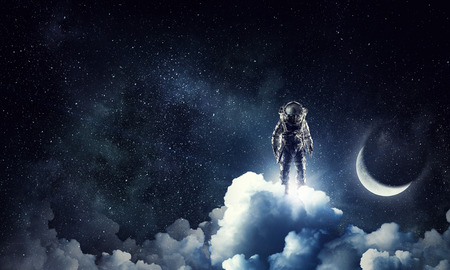 Astronaut in dark sky and moon planet. Elements of this image furnished by NASA Stock Photo