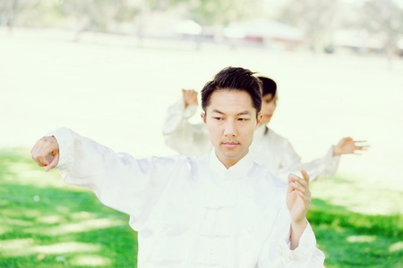 Handsome man practicing thai chi Stock Photo