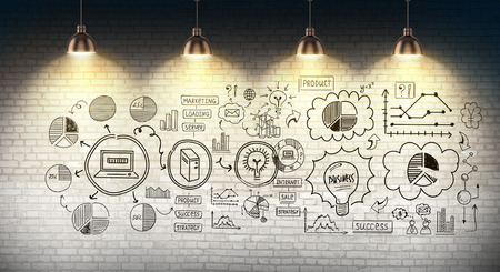 Business plan sketch drawn on wall with lamps hanging above it Фото со стока - 85497678