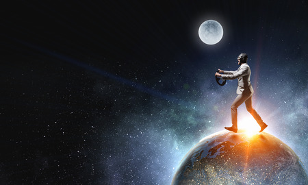 Funny aviator running on Earth planet. Elements of this image are furnished by NASA