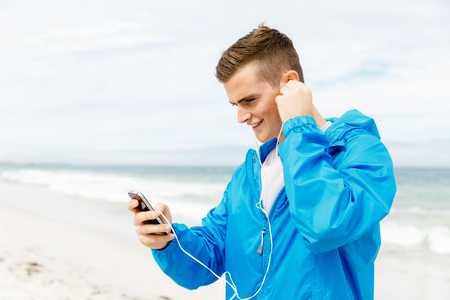 Sports and music. man getting ready for jogging Banco de Imagens - 85810705
