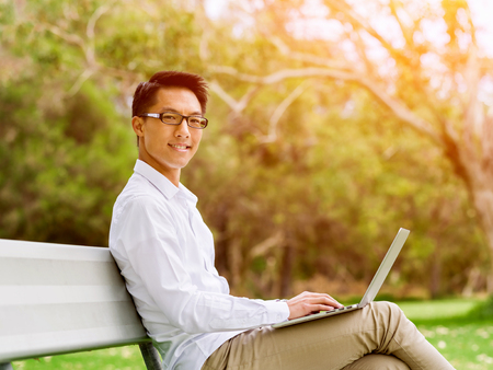 Young businessman during his break in park