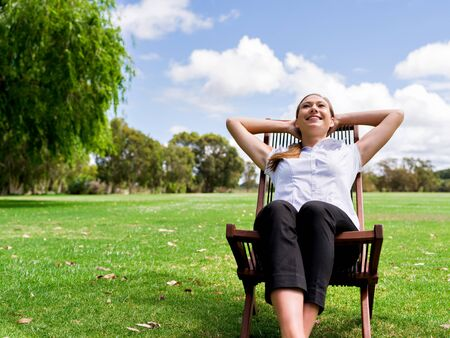 Young businesswoman relaxing during her break in park Stock Photo