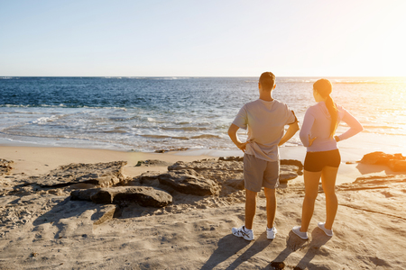 Young couple on beach training and exercising together Stock Photo