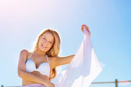 Young woman relaxing on the beach Stock Photo