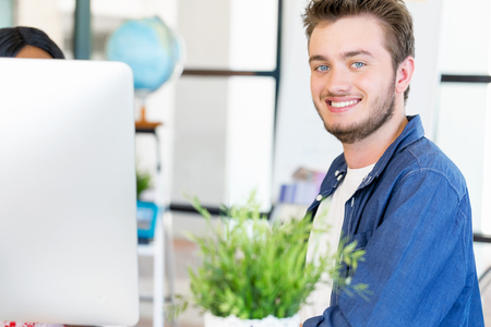 designer: Young man working in office