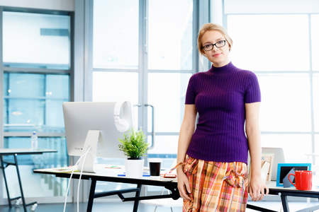 designer: Creative business woman in office