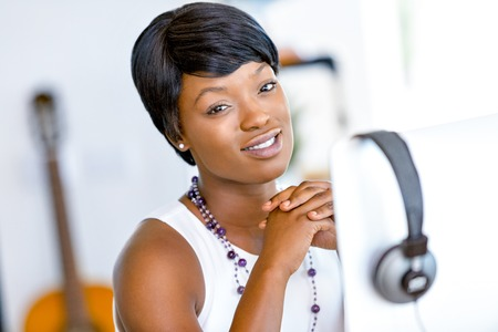 african business: Portrait of businesswoman working at her desk in office