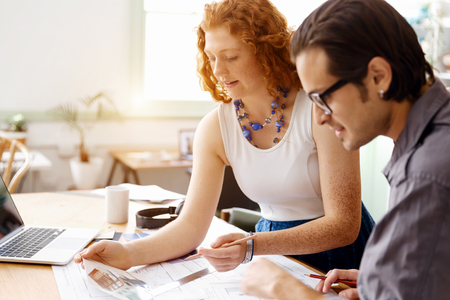 designer: Two young architects in office Stock Photo