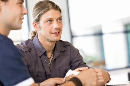 designer: Young man in casual in office Stock Photo