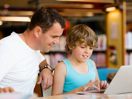 Little boy and his father with laptop Stock Photo