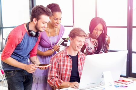 designer: Young office workers or students as a team