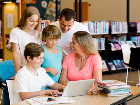 Family in library Stock Photo