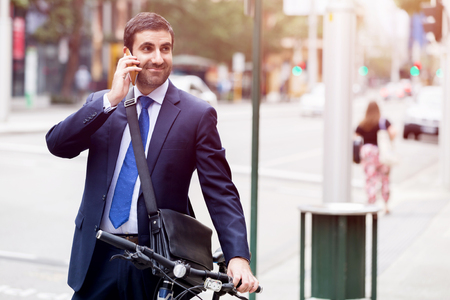 Young businessmen with a bike Stock fotó - 87739495