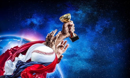 Hand of winner tighten the cup against blue sky background. Stock Photo