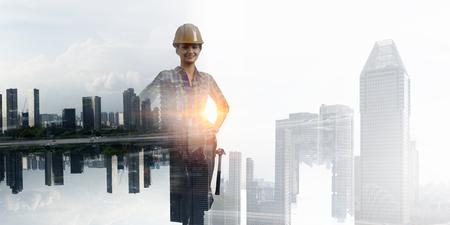 Builder woman against cityscape