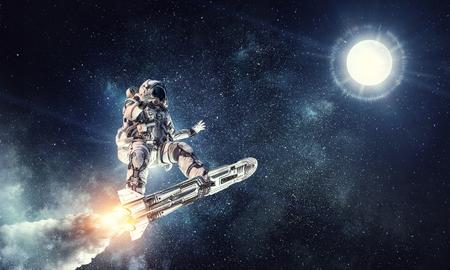 宇宙飛行士サーフィン暗い空。ミクスト メディア 写真素材