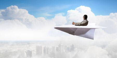 Aviator in paper plane. Mixed media