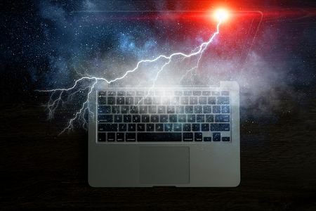Laptop with lightning. Mixed media 版權商用圖片