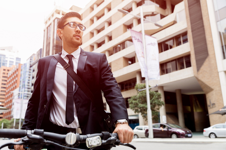 Young businessmen with a bike Stock fotó - 88400923