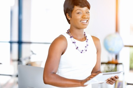 Young woman in office using tablet