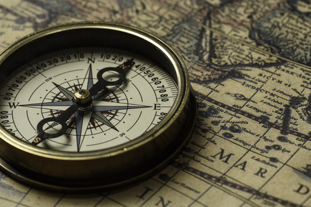 Retro compass with old map Stock Photo