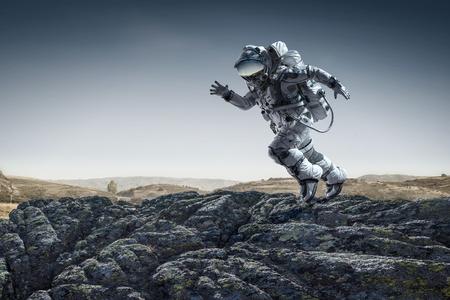 Spaceman running fast. Mixed media Banco de Imagens - 88723083