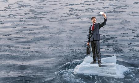 ice floe: Surfing sea on ice floe. Mixed media Stock Photo