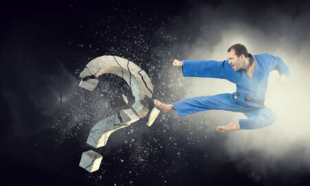 Karate man in action. Mixed media Stock Photo