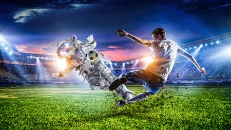 Astronaut play soccer game Stock Photo