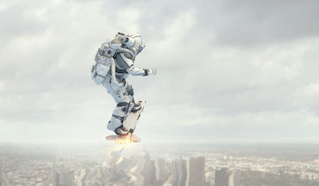 Spaceman on flying board. Mixed media Stock Photo