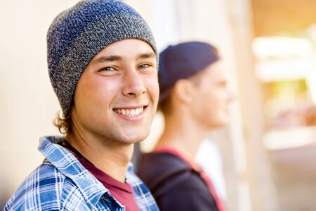 Teenage friends standing at the street Banco de Imagens - 89084154