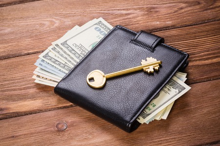 Money is key to open doors Stock Photo