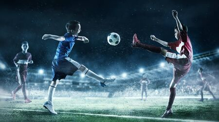 Children play soccer. Mixed media Stock Photo