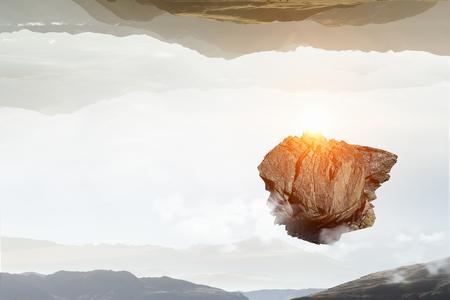 石は空に飛んでいきます。ミクスト メディア 写真素材