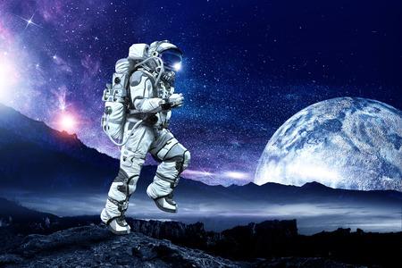 Spaceman running fast. Mixed media Stok Fotoğraf
