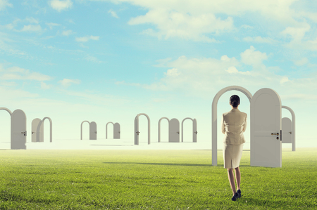 Elegant business lady outdoor and opened door. Mixed media Stock Photo - 89956298
