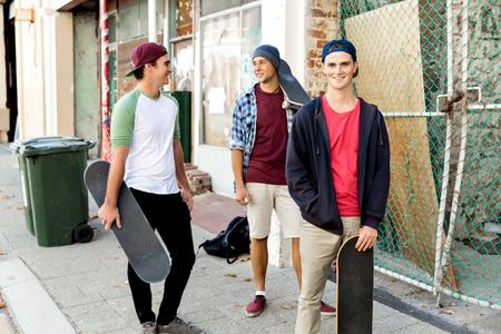 Teenage friends walking at the street
