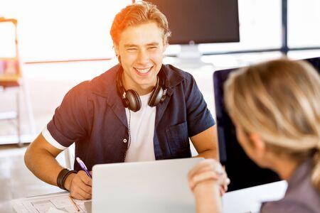 Happy young man designer working