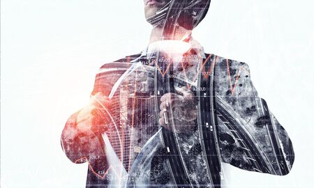 Double exposure of super hero businessman and modern city