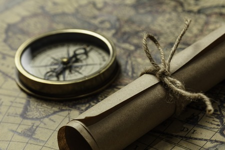 Old map compass and roll on table Фото со стока - 90249912