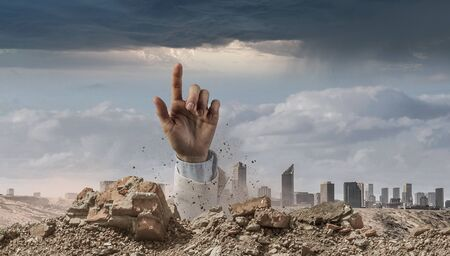 Hand coming out of ground as concept for never give up Zdjęcie Seryjne - 90249765