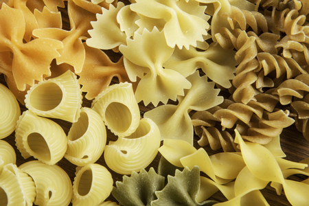 Variety of types and shapes of dry Italian pasta Stock Photo