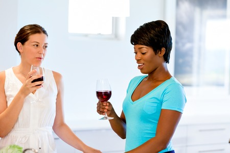 Female friends with glass of wine Stock Photo