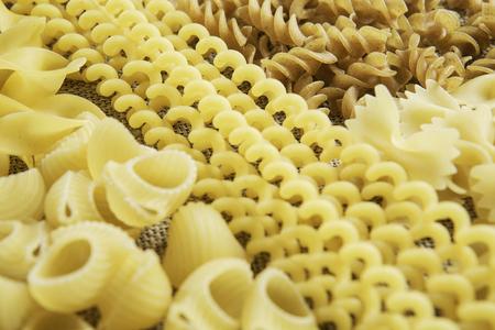 Lots of various dry noodles on table 版權商用圖片