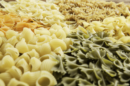 Lots of various dry noodles on table Stock Photo