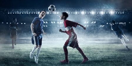 Children play soccer. Mixed media Stock Photo