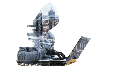 Double exposure of hacker man working on laptop and cityscape on white background
