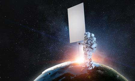 Spaceman with banner. Mixed media Standard-Bild