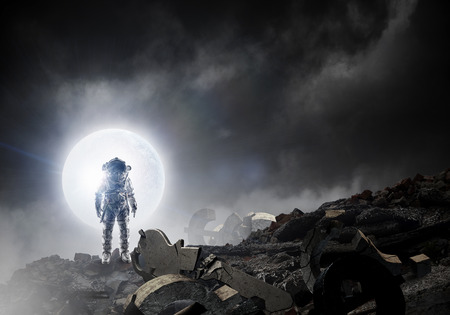 Astronaut standing outdoor. Mixed media Stock Photo
